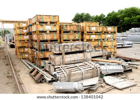 Arrangement of Steel angle & pallets in warehouse - stock photo