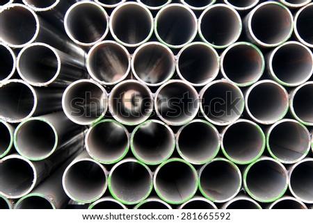 Arrangement of steel pipes - stock photo