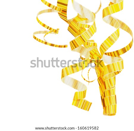 Arrangement of Striped Yellow Curly Hanging Party Streamers isolated on white background - stock photo