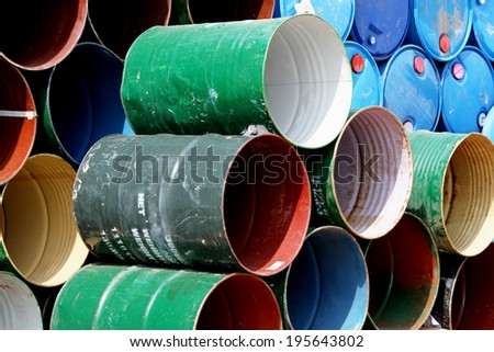 Arrangement of used color painting, oil tanks - stock photo