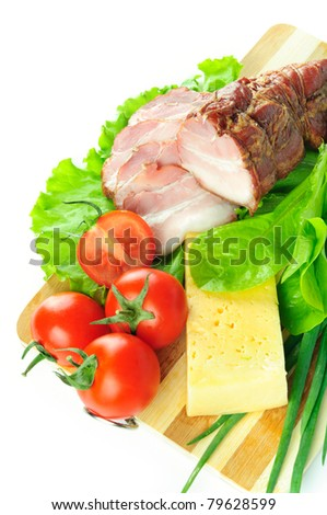 Arrangement with meat smoked bacon, tomatoes and cheese on Cutting board