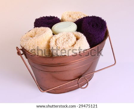 Arrangment of towels and soap - stock photo