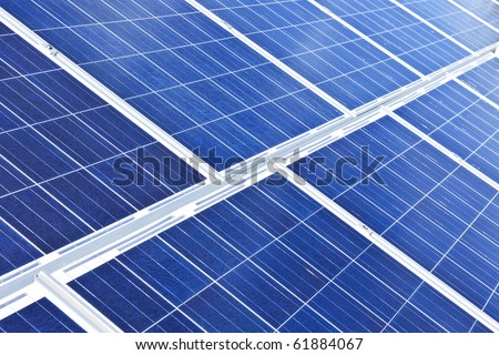Array of alternative energy photovoltaic solar panels - stock photo
