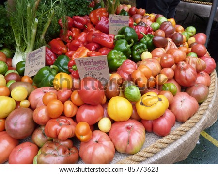 Array of heirloom tomatoes and fall vegetables