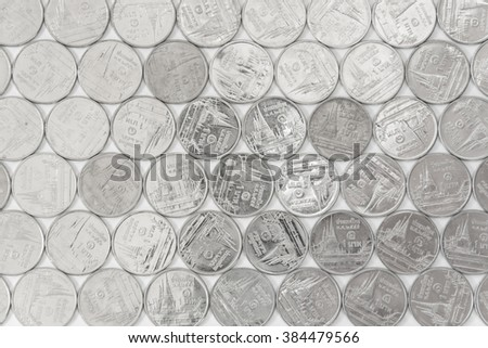 Arrays of Thai Baht money coins in silver color - stock photo