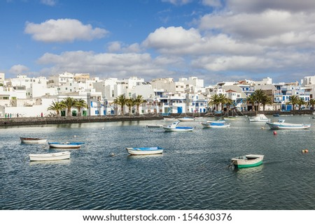 ARRECIFE, SPAIN - DEC 23: Charco de San Gines on midday on Dec 23,2010 in Arrecife, Spain. The harbor area was remodelled by Canarian architect Caesar Manrique in 1984.