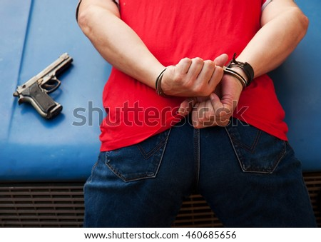 arrest and shackling in handcuffs armed criminal in mask