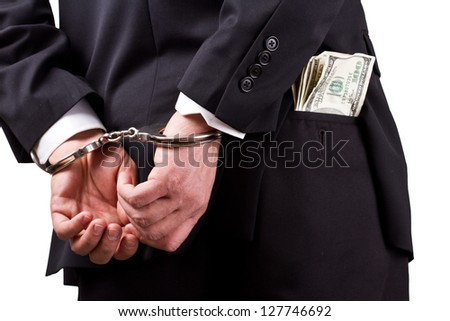 arrested businessman holding hundred dollar bills isolated on a white background - stock photo