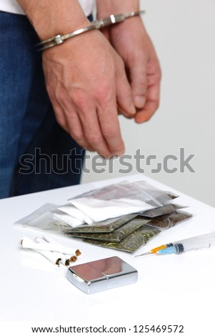 arrested drug dealer - stock photo