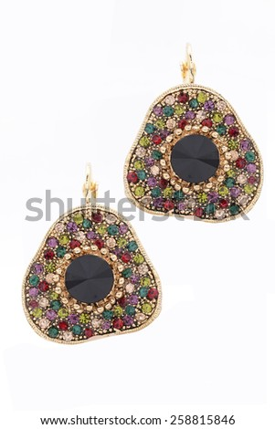 arrings with precious stones  on white background - stock photo