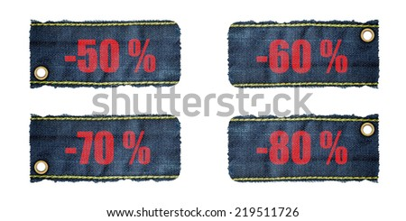 arrival label sale percents,Jeans background - stock photo