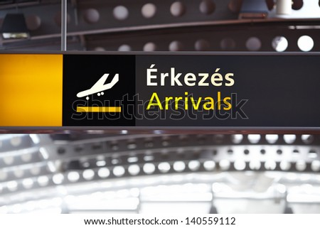 Arrivals airport sign in Hungary with Hungarian text - stock photo