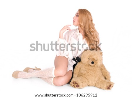 Arrogant, aristicrat sexy girl with lovely teddy - stock photo