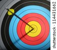 Arrow hit goal ring in archery target. - stock photo