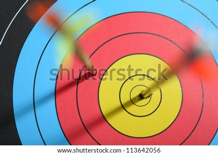 arrow hit target, one hit bull's eye - one missed - stock photo