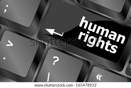 arrow keyboard keys, computer button with human rights word on it - stock photo