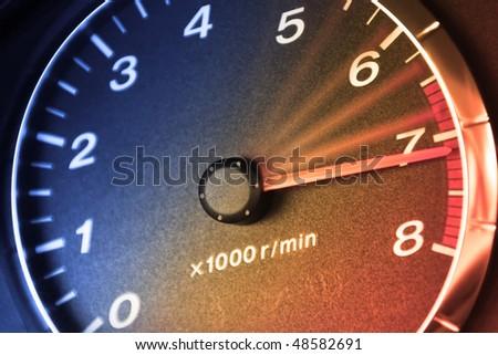 Arrow of tachometre in red zone - stock photo