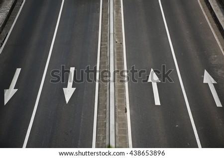 Arrow on asphalt. - stock photo