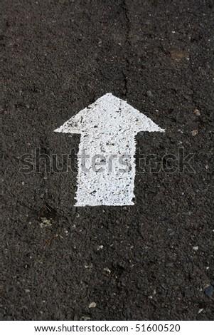 arrow on the road - stock photo