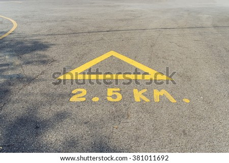 Arrow on the road, yellow  - stock photo