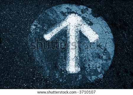 Arrow sign on an old asphalt texture background