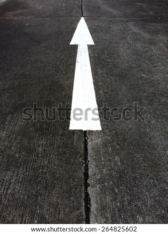 Arrow sign paint on the road - stock photo