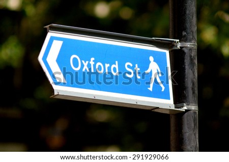 Arrow sign show pedestrians the way to Oxford street the most famous famous shopping street in London England and the United Kingdom. - stock photo