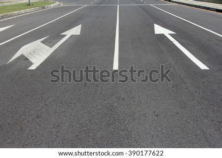 Arrow signs as road markings on a street