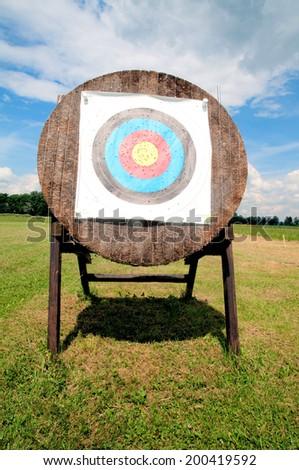 Arrow target shield on a shooting arena - stock photo