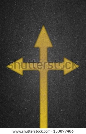 Arrow three way on the road - stock photo