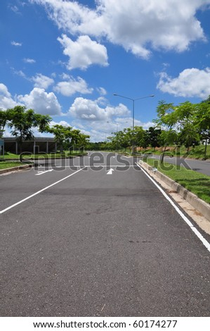 Arrow traffic on the road surface - stock photo