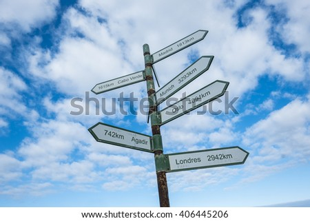 arrow with direction in a blue sky for your adventure trip and vacation in exotic place