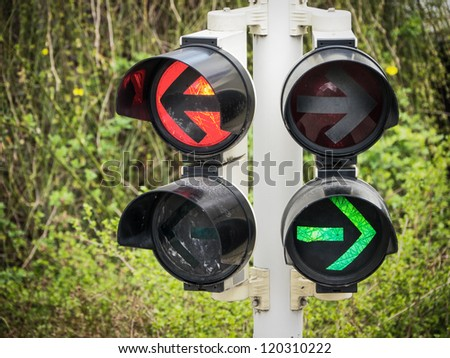 arrows at a traffic light in berlin - germany - stock photo
