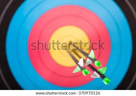 Arrows in archery target - stock photo