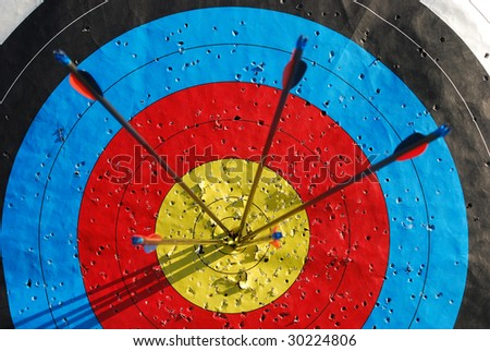 Arrows in the center of a target - stock photo