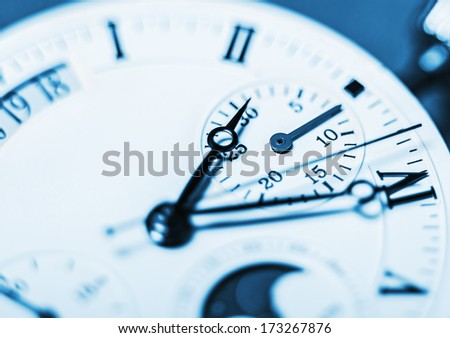 Arrows mechanical Clock. Very shallow depth of field and Focus on the clockwise - stock photo