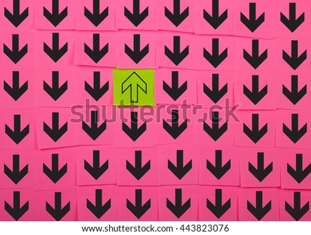 Arrows. Opposite direction concept. Background of pink sticky notes.