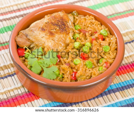 Arroz Con Pollo - Chicken and rice cooked with sofrito and beer. - stock photo