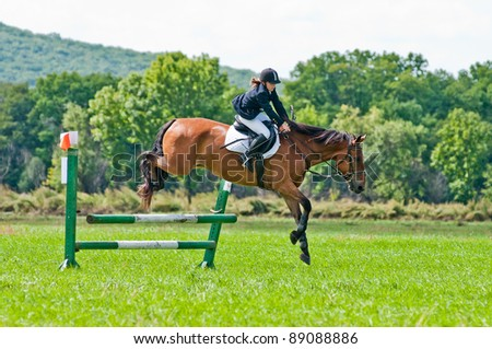 "ARSENEV, RUSSIA - SEPTEMBER 03:  Unidentified rider in action rides horse at the Riding show ""The Cup of the Governor of the Primorsky Territory, 2011"" on Sept 03, 2011 in Arsenev, Russia"