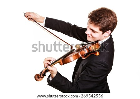 Art and artist. Young elegant man violinist fiddler playing violin isolated on white. Classical music. Studio shot.