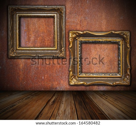 art backdrop interior setting with old painting frames on wall