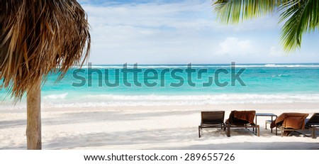 art Beach chair and umbrella on sand beach. Concept for rest, relaxation, holidays, spa, resort. - stock photo