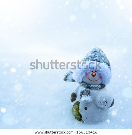 Art Christmas snowman and blue snow background - stock photo