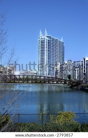 art deco building in city of Atlanta with pond and bridge in foreground - stock photo