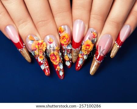 Art design female nails on blue background. - stock photo