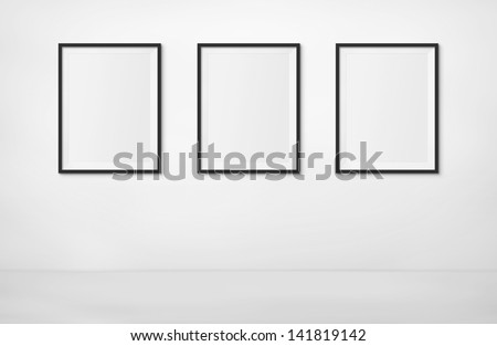 Art Exhibition Concept. 3 Blank Photo Frames on display at an exhibition. Put your own image inside. - stock photo