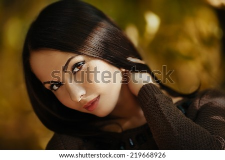 Art fashion portrait of young gorgeous brunette in the fall. Shallow depth of field - stock photo