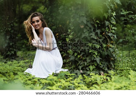 Art fashion portrait of young woman walking in the woods - stock photo