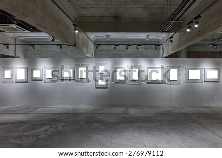 Art gallery hall with empty picture frames - stock photo