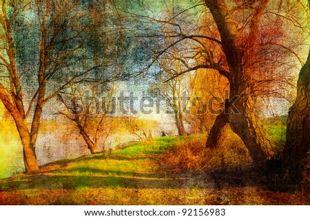 Art grunge landscape showing trees beside the river on beautiful autumn day.